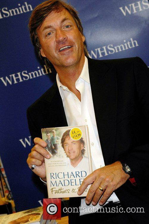 Richard Madeley signs copies of his new book...