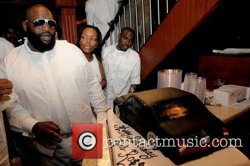Rick Ross cuts his birthday cake during his...