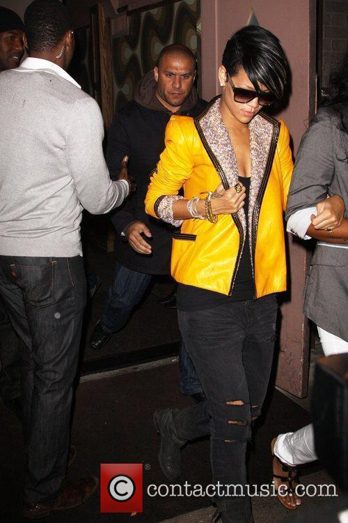 Rihanna clubbing with friends in Manhattan and wearing...