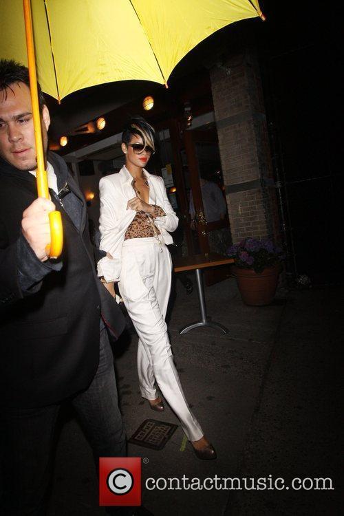 Leaves Da Silvano restaurant wearing a white pant...