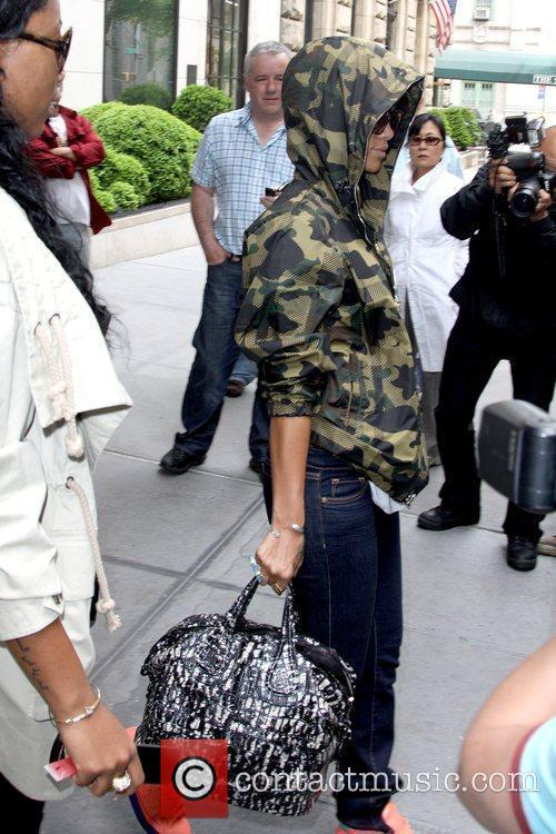 Rihanna leaving her Manhattan hotel while wearing a...