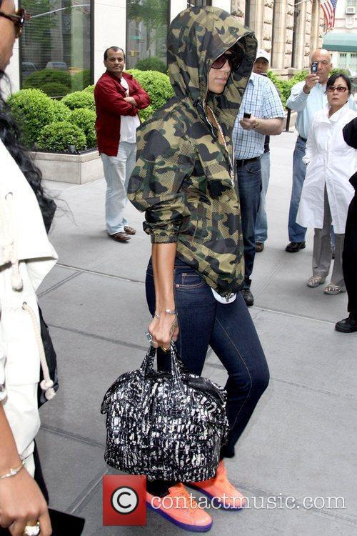 Leaving her Manhattan hotel while wearing a camouflage...