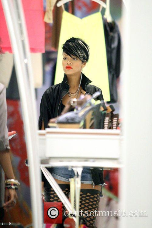 Rihanna shopping at Marni in Soho wearing a...