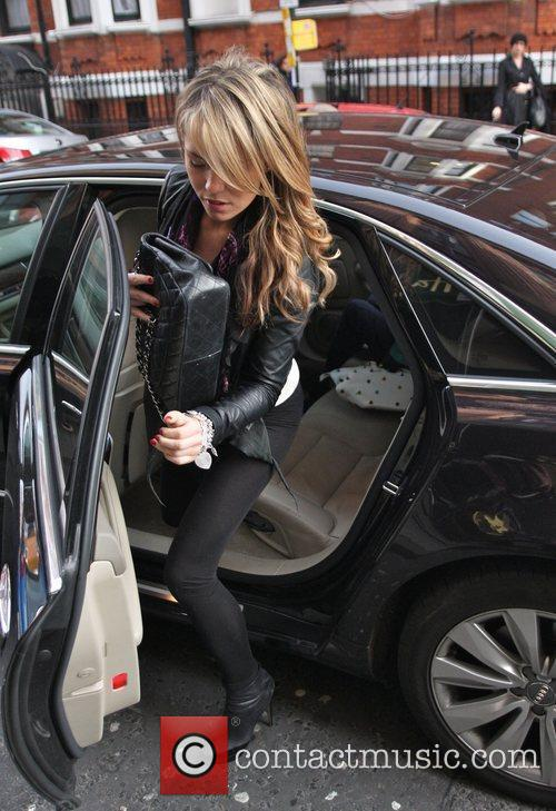 Arrives at Harrods department store with fellow WAG...