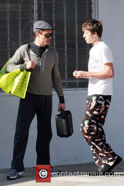 Father and son spotted out shopping for clothes...