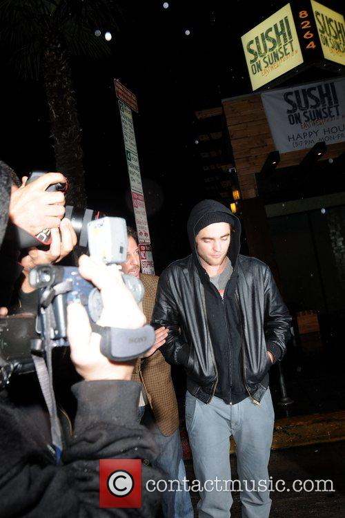 'Twilight' star Robert Pattinson, sporting a black hoodie...
