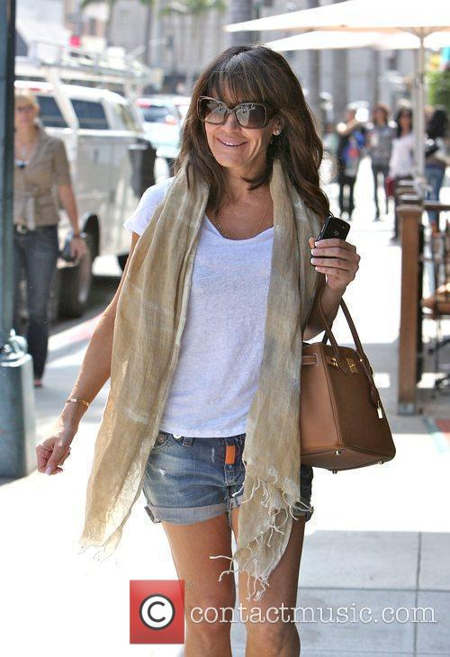Walking in Beverly Hills after having her nails...