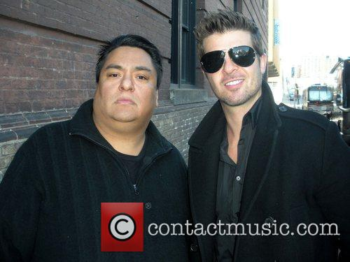 Poses with a fan outside Lyric Opera House...