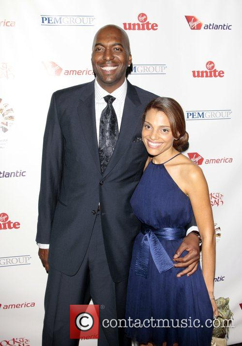 John Salley and guest attend the Virgin Unite...