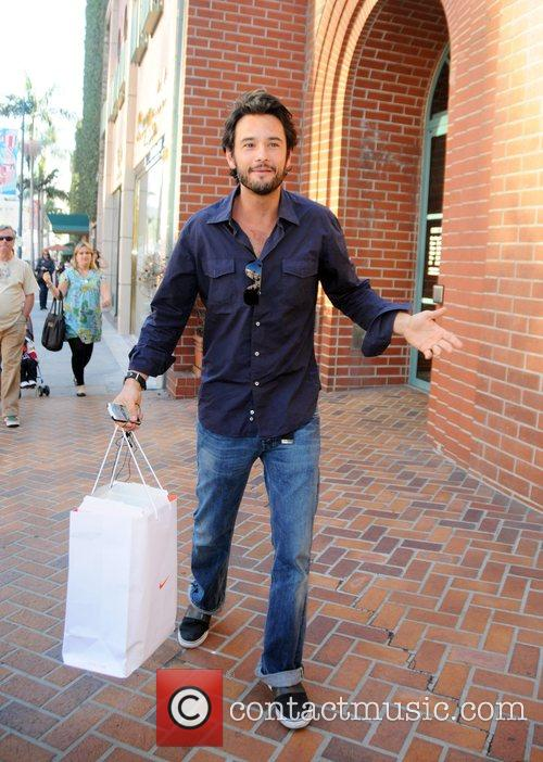 Leaving a medical building in Beverly Hills carrying...