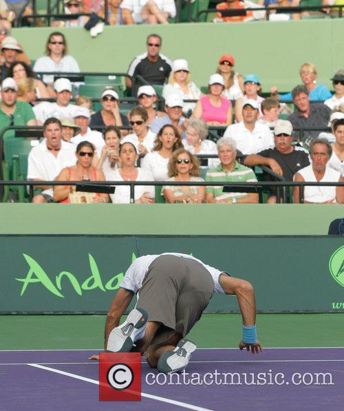Roger Federer Takes A Spill While Playing Against Taylor Dent 1