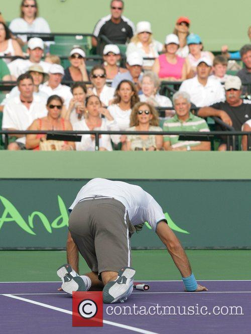 Roger Federer Takes A Spill While Playing Against Taylor Dent 3