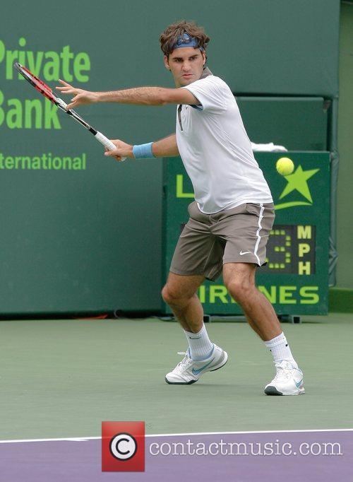 Roger Federer plays against Nicolas Kiefer during day...