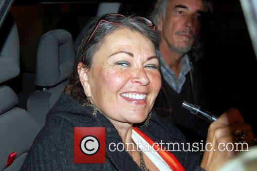 Roseanne Barr  signs autographs for waiting fans...