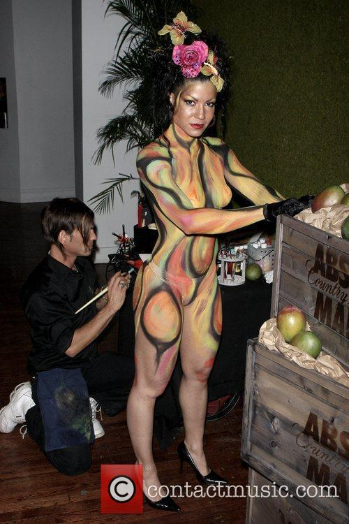 Model  getting painted at the launch of...