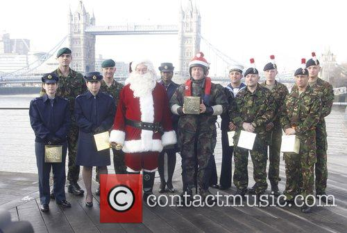 Ross Kemp poses with the crew of the...