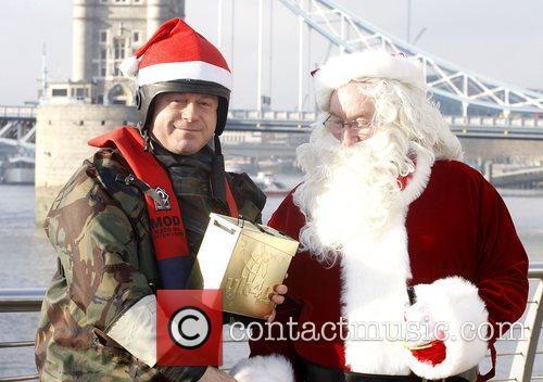 Ross Kemp  poses meets Father Christmas Kemp...