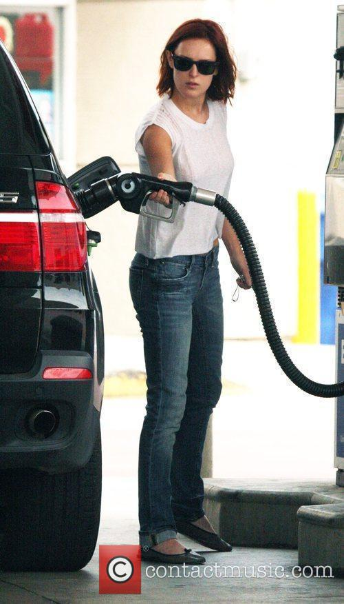 Stops at a Santa Monica gas station to...