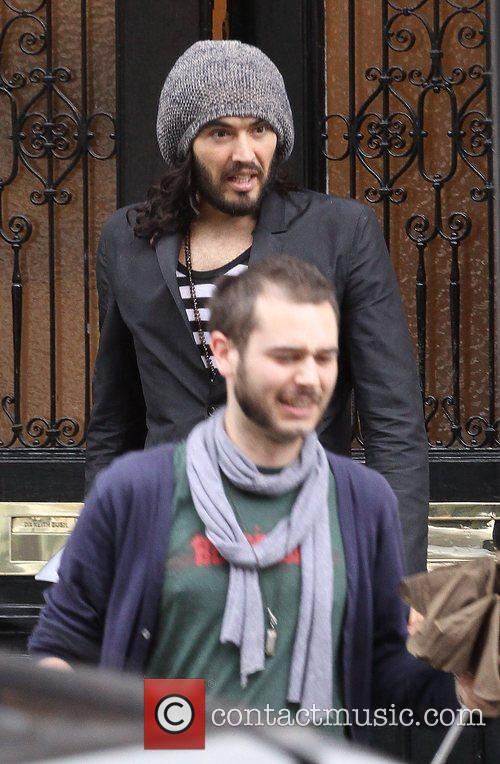 Russell Brand leaving a meeting with his personal...