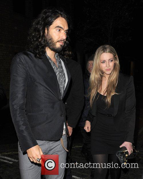 Russell Brand  leaves Claridges hotel with a...