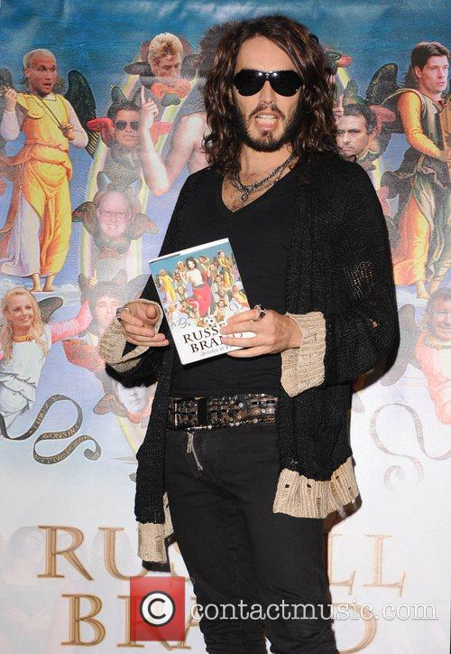 At a photocall for his book 'Articles of...