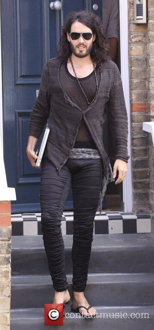 Leaving home wearing his trademark tight-fitting trousers