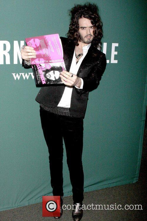 Russell Brand  signs copies of his book...