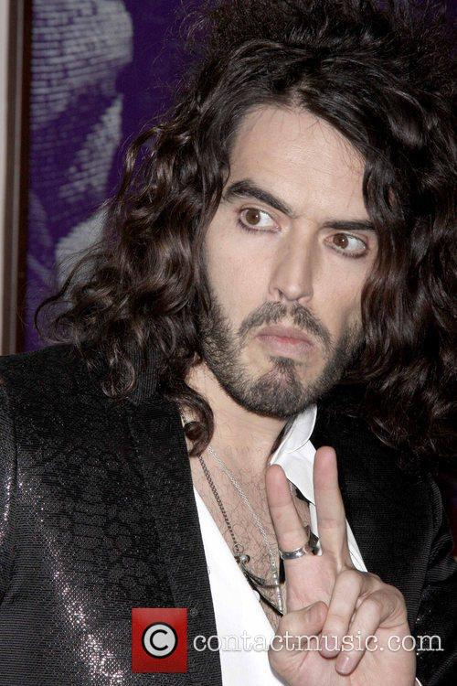 Signs copies of his book 'Russell Brand: My...