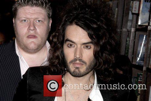 Russell Brand  arrives for his signing at...