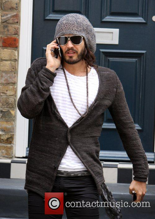 Talks on his mobile phone as leaves his...