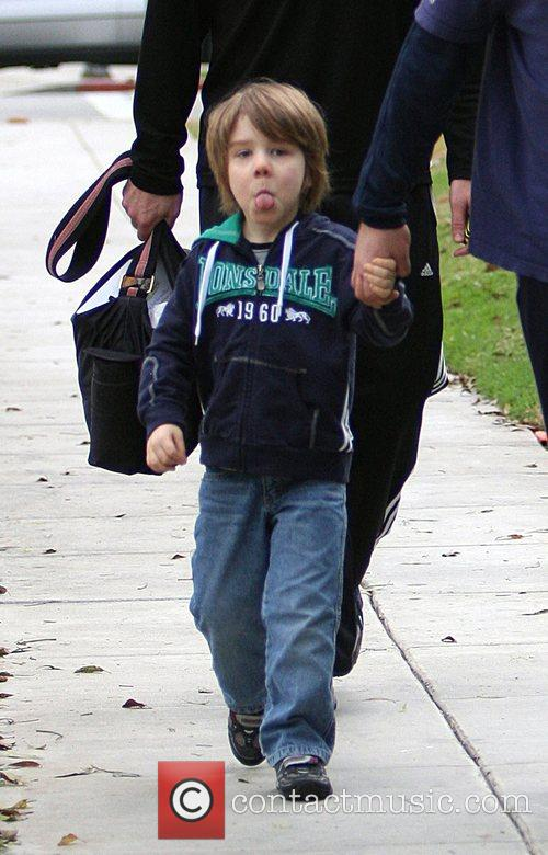 Russell Crowe's son Charlie sticks his tongue out...