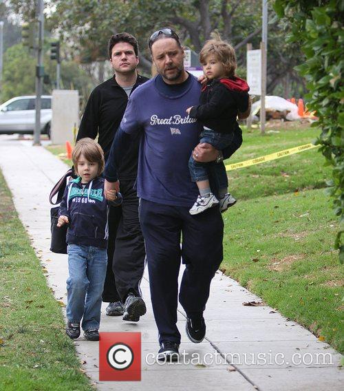Russell Crowe, wearing a Great Britain t-shirt, holds...
