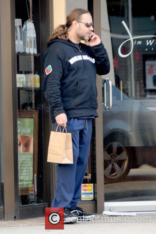 Russell Crowe  smoking while out and about...