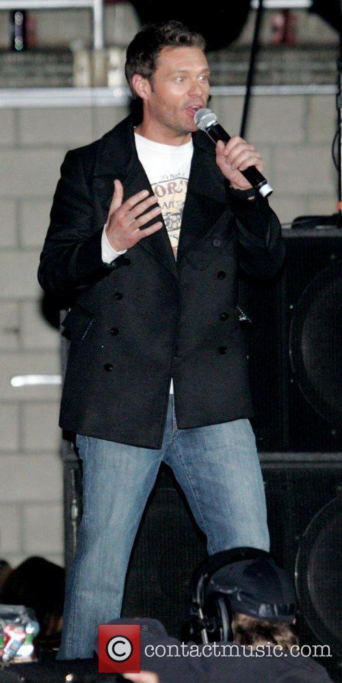 Ryan Seacrest on stage hosting Katie Perry in...