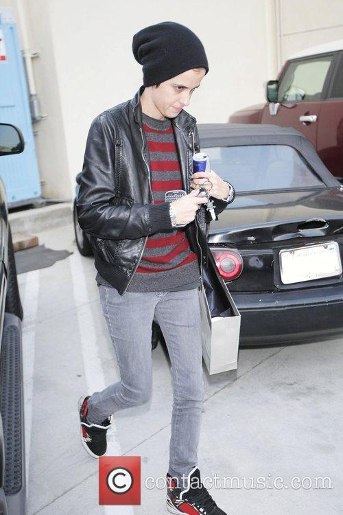 Samantha Ronson carrying a large shopping bag and...