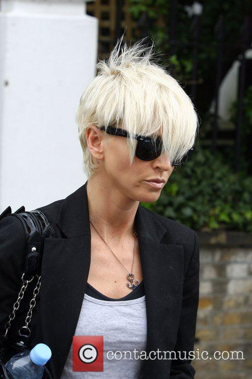 Sarah Harding leaving home with her dog Corker...