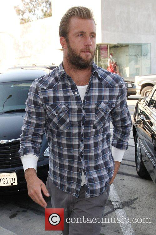 Scott Caan is followed by photographers as he...