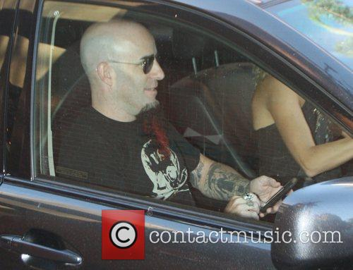 Scott Ian, Rhythm Guitarist For The Metal Band Anthrax and Checks His Iphone While Driven Around Beverly Hills 3