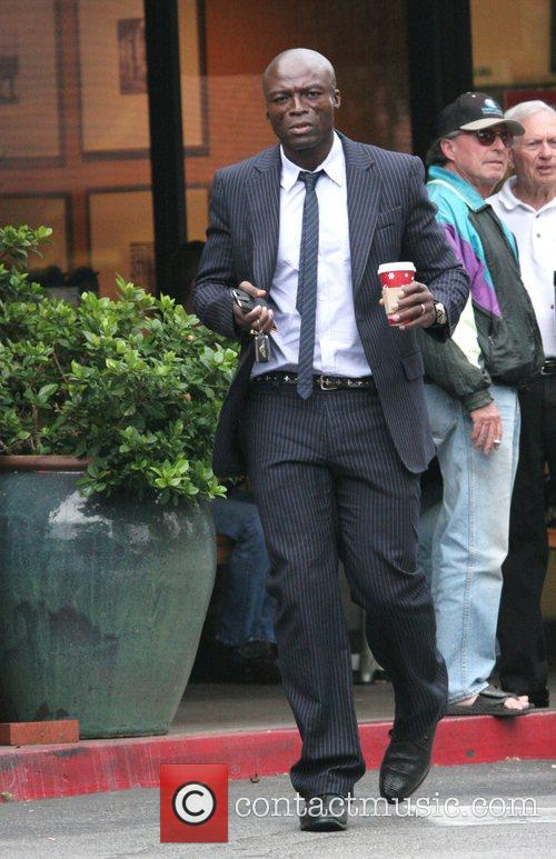 Singer Seal wearing a smart pinstriped suit leaving...