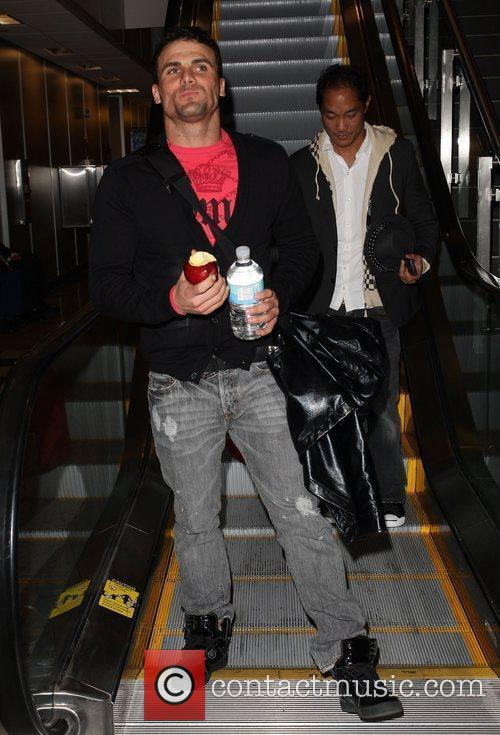 Jeremy Jackson eating an apple and carrying a...