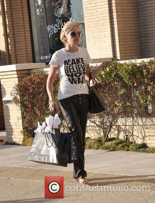 Sharon Stone shops at Barneys New York wearing...