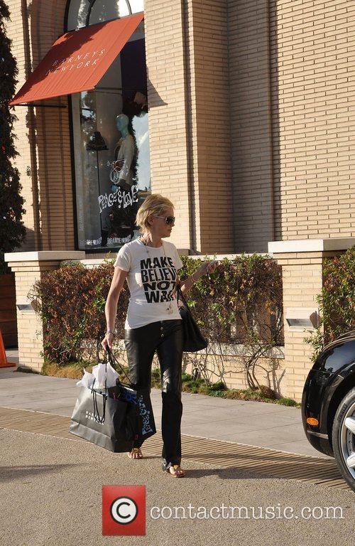 Shops at Barneys New York wearing a t-shirt...