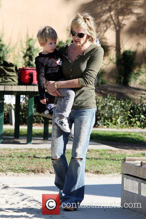 Sharon Stone  taking a young child to...