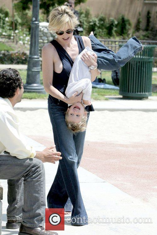 Sharon Stone exposes her nipple while playing with...