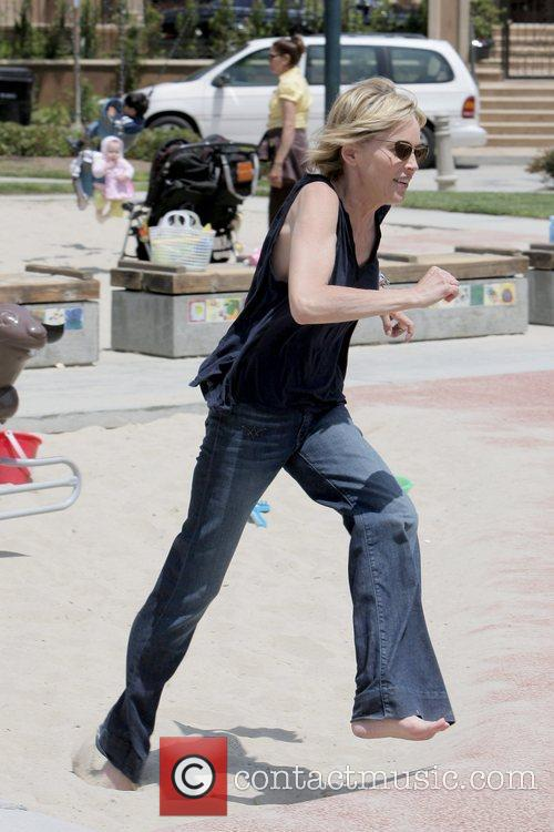 Sharon Stone running Sharon Stone and a male...