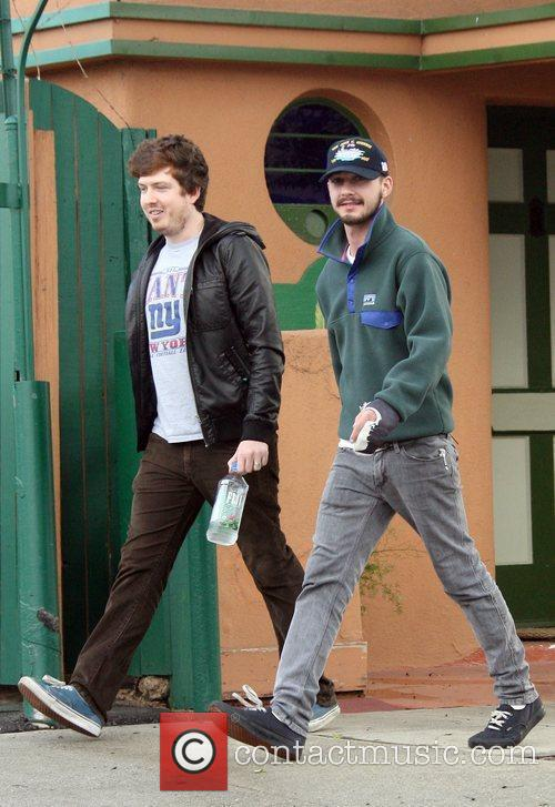 Shia LaBeouf out walking with a friend before...