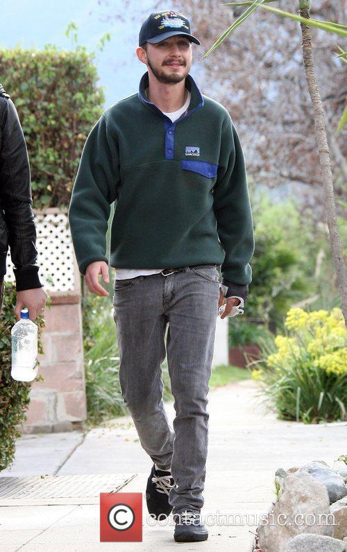 Shia LaBeouf - out walking with a friend before stopping ...