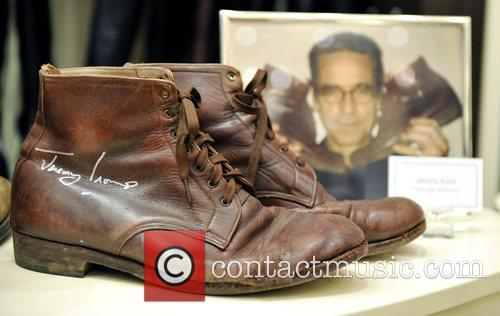 Jeremy Irons' donated shoes are displayed at the...