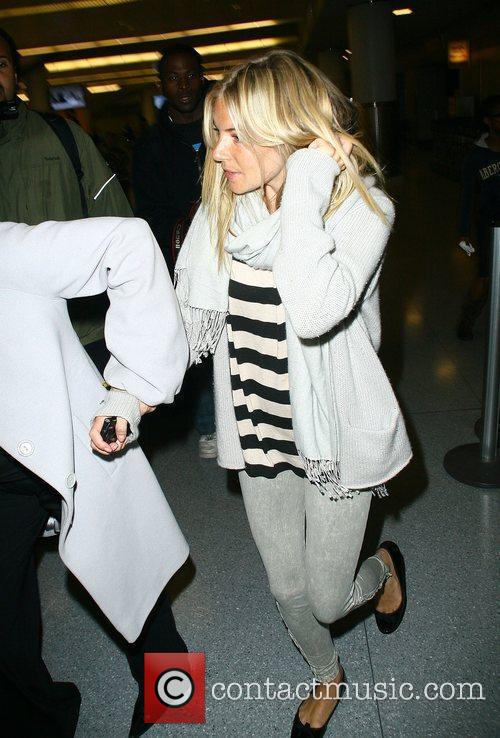 Sienna Miller arriving in New York City from...
