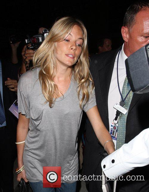 Sienna Miller arrives at LAX airport to depart...